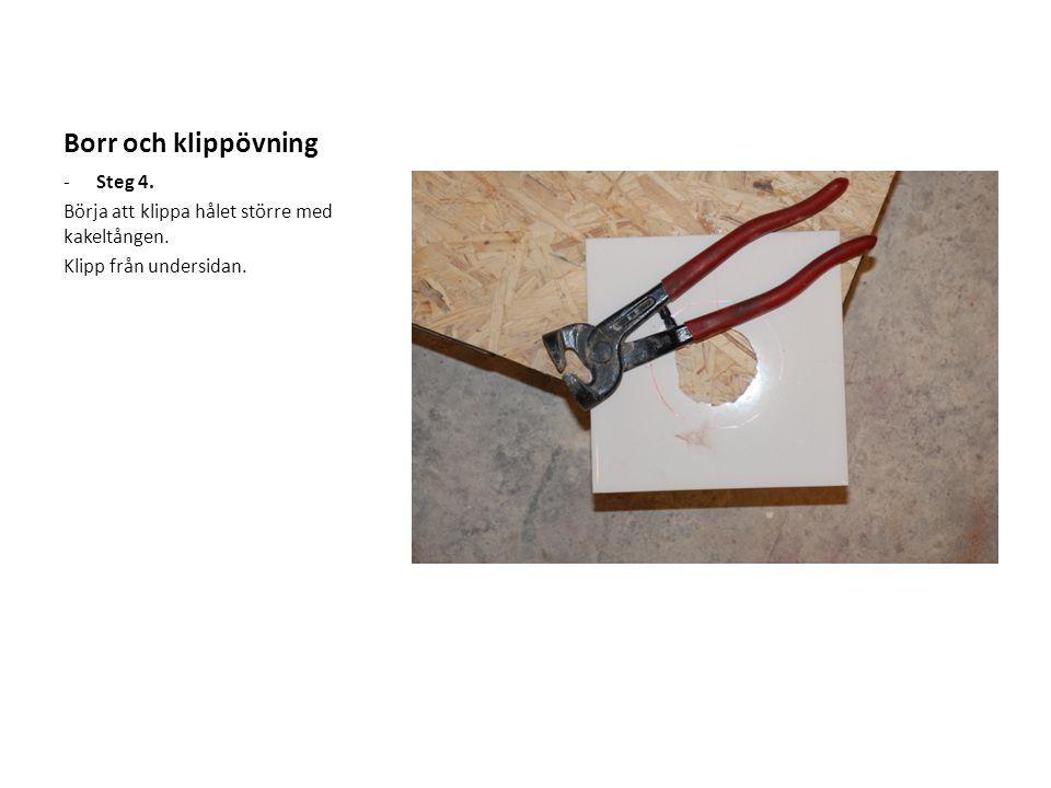 Borr och klippövning -Steg 4. Börja att klippa hålet större med kakeltången. Klipp från undersidan.