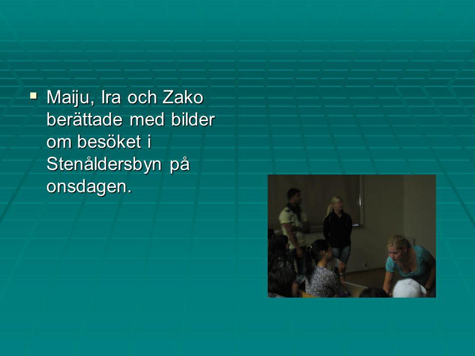 Maiju, Ira och Zako berättade med bilder om besöket i Stenåldersbyn på onsdagen.