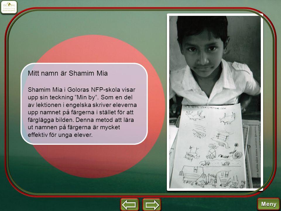 """Mitt namn är Shamim Mia Shamim Mia i Goloras NFP-skola visar upp sin teckning """"Min by"""". Som en del av lektionen i engelska skriver eleverna upp namnet"""
