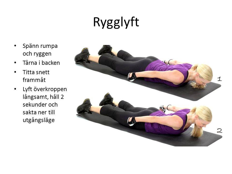 Rygglyft Spänn rumpa och ryggen Tårna i backen Titta snett frammåt Lyft överkroppen långsamt, håll 2 sekunder och sakta ner till utgångsläge