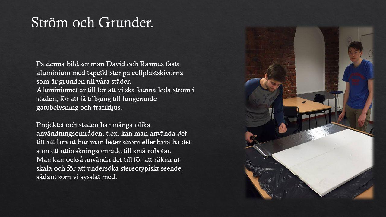 På denna bild ser man David och Rasmus fästa aluminium med tapetklister på cellplastskivorna som är grunden till våra städer.