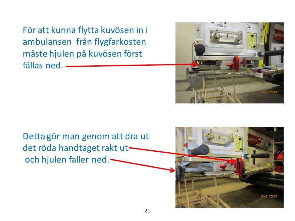 För att kunna flytta kuvösen in i ambulansen från flygfarkosten måste hjulen på kuvösen först fällas ned.