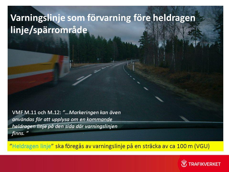 """Spärrlinje med förvarning """"Heldragen linje"""" ska föregås av varningslinje på en sträcka av ca 100 m (VGU) Varningslinje som förvarning före heldragen l"""