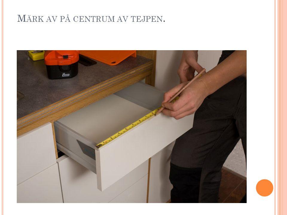M ÄRK AV PÅ CENTRUM AV TEJPEN.