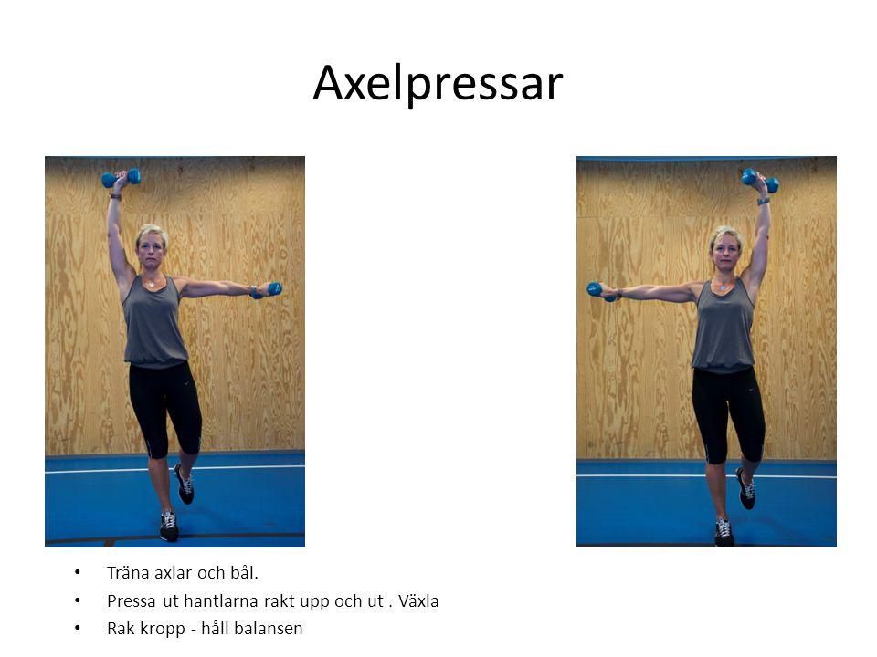 Axelpressar • Träna axlar och bål. • Pressa ut hantlarna rakt upp och ut. Växla • Rak kropp - håll balansen