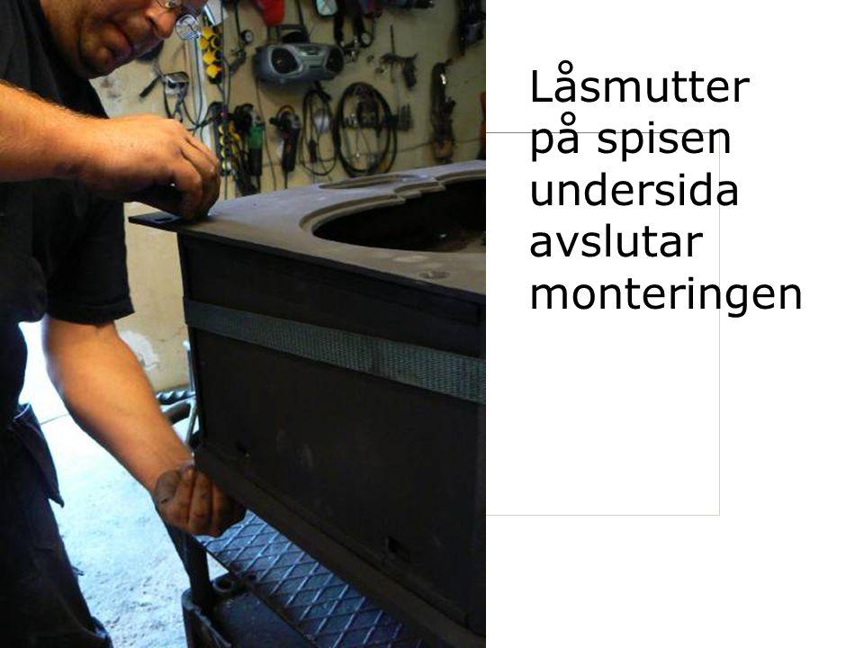Låsmutter på spisen undersida avslutar monteringen