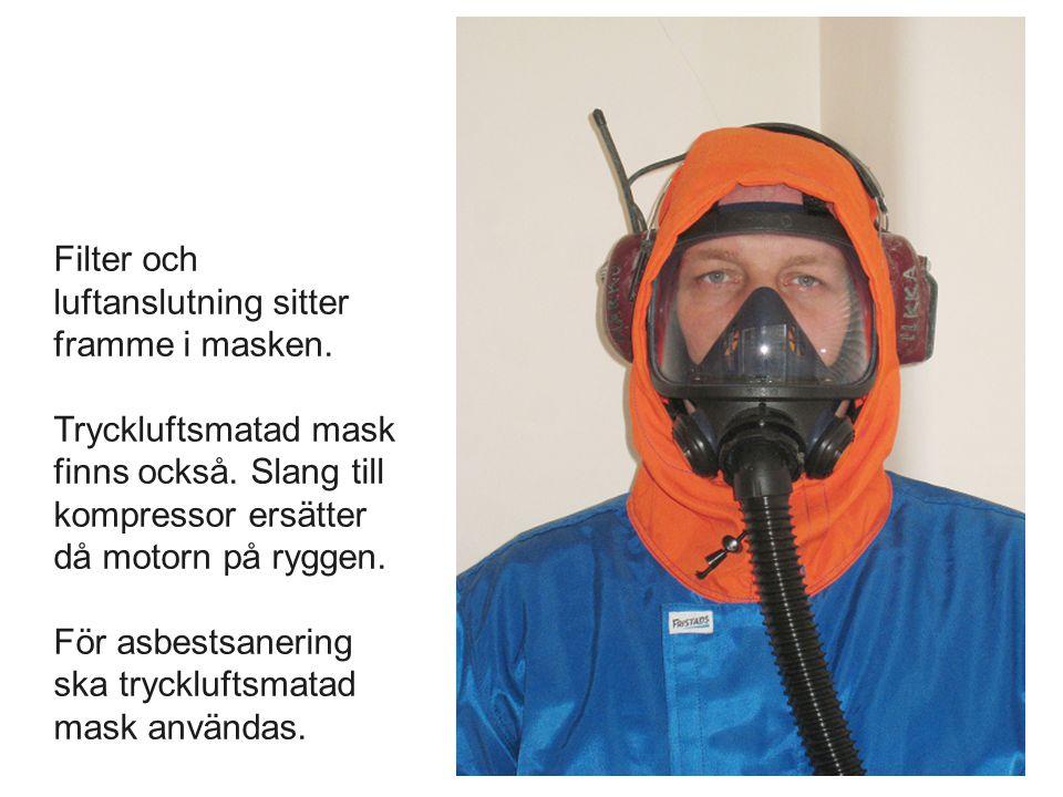 Filter och luftanslutning sitter framme i masken. Tryckluftsmatad mask finns också. Slang till kompressor ersätter då motorn på ryggen. För asbestsane