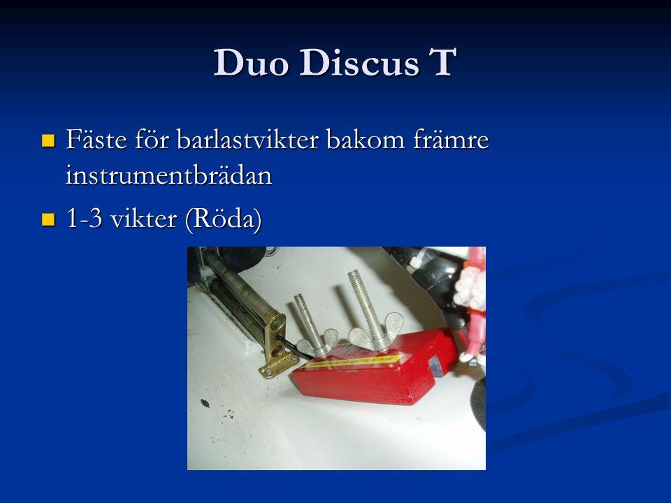 Duo Discus T Fäste för barlastvikter bakom främre instrumentbrädan Fäste för barlastvikter bakom främre instrumentbrädan 1-3 vikter (Röda) 1-3 vikter (Röda)