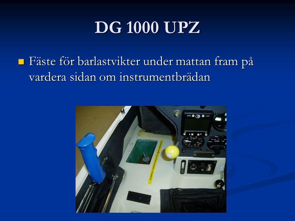 DG 1000 UPZ Fäste för barlastvikter under mattan fram på vardera sidan om instrumentbrädan Fäste för barlastvikter under mattan fram på vardera sidan om instrumentbrädan