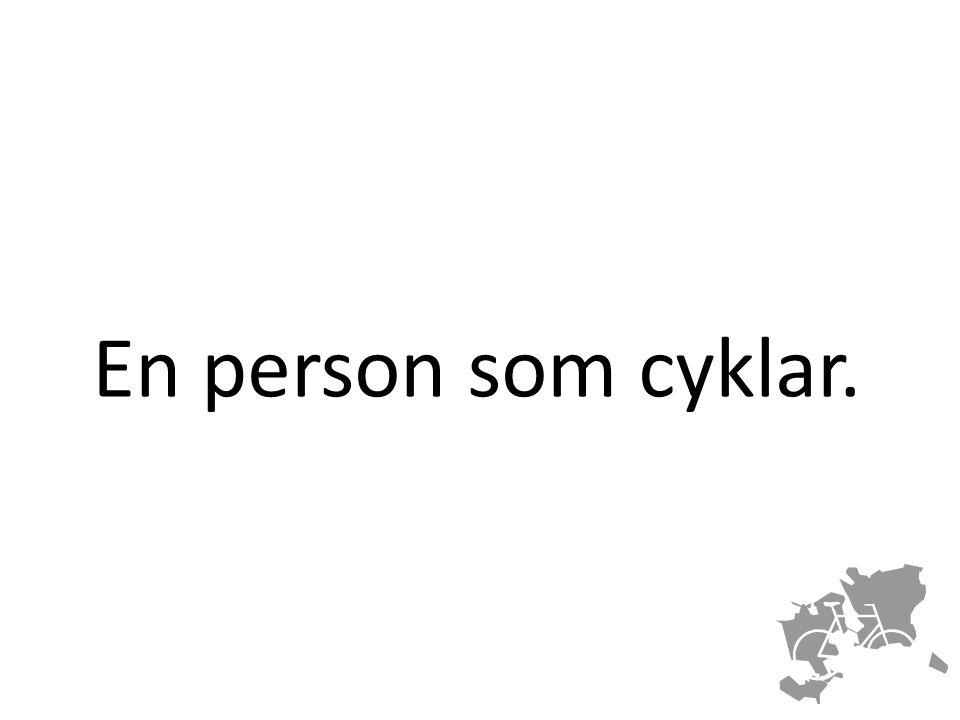 En person som cyklar.